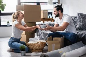 happy young couple packing up their home for a move