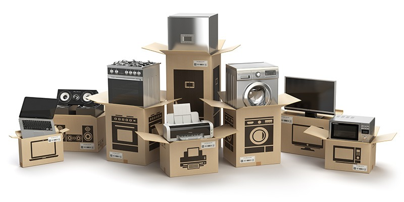 household electronic devices being packed in moving boxes