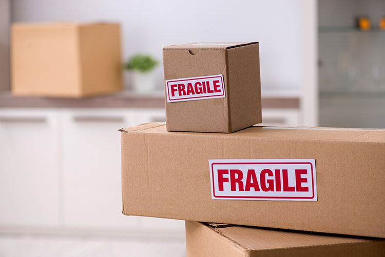 moving and storage boxes labeled as fragile